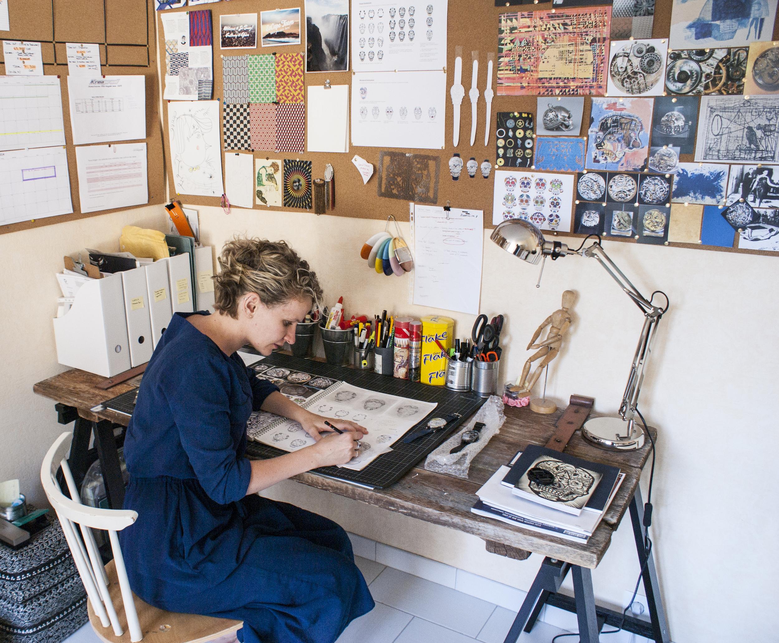 Fiona Krüger hand sketching her designs.