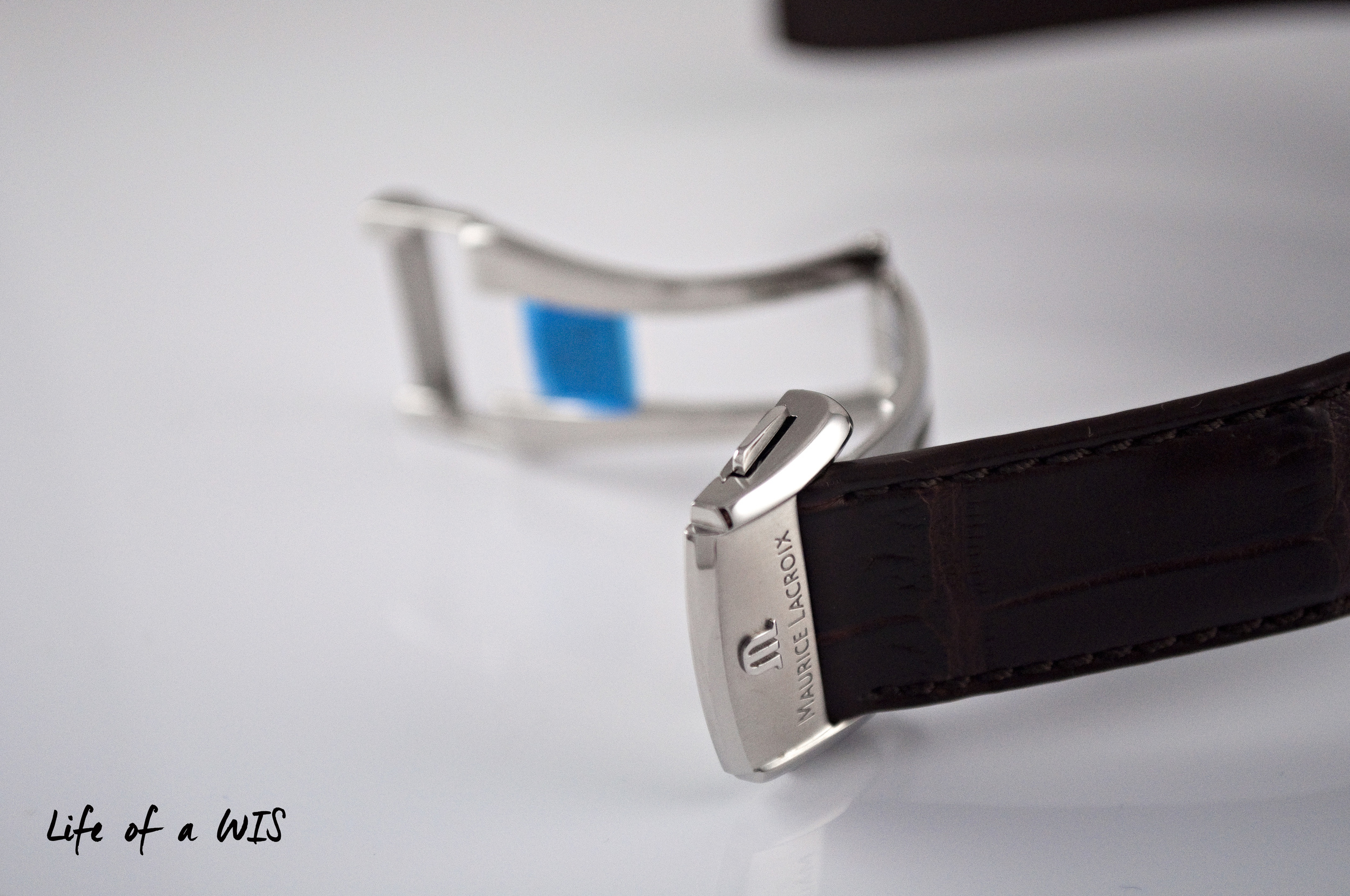 """Single-sided deployant buckle with embossed """"M""""."""
