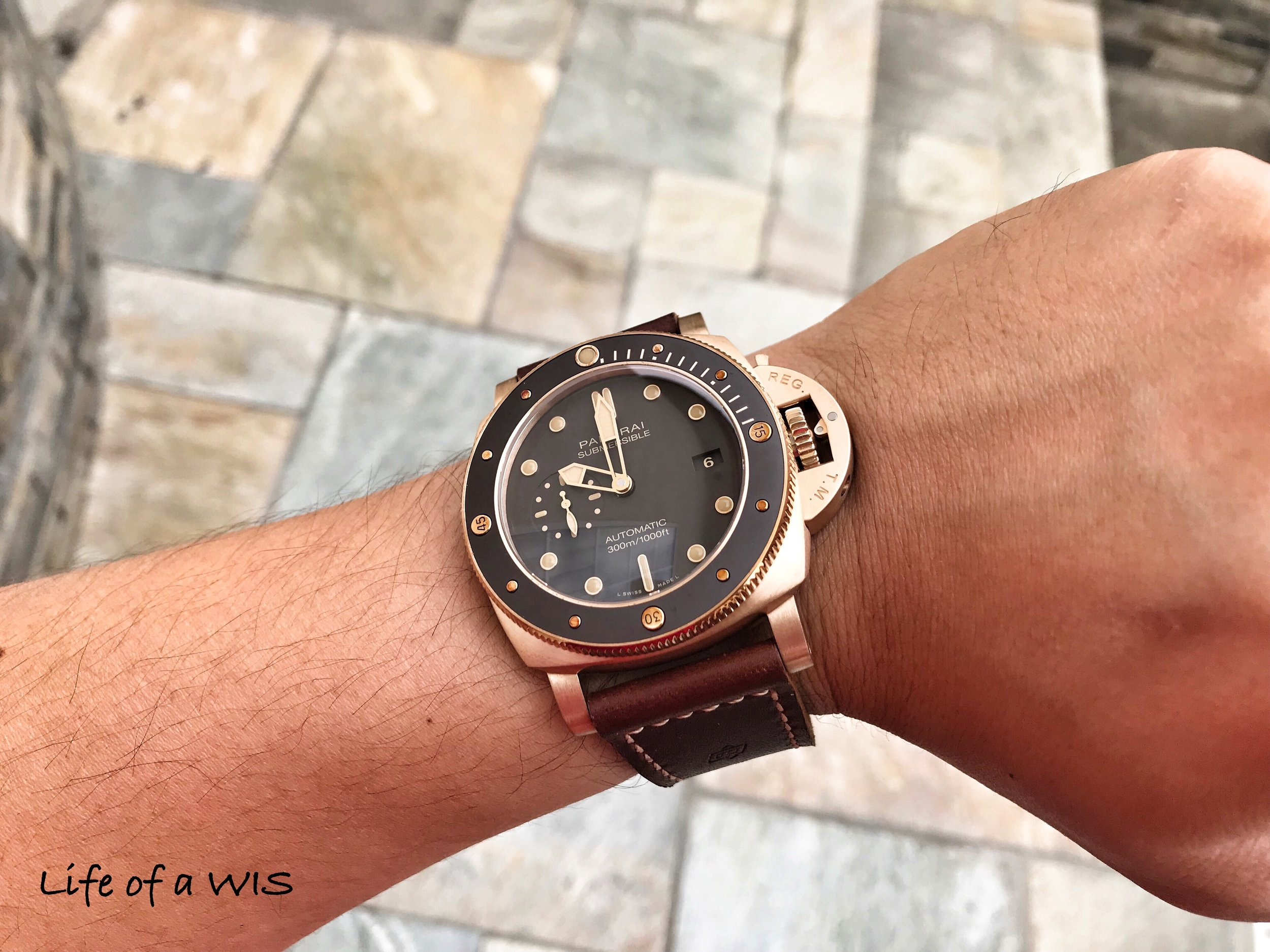 Though they appear black in photos, the dial and bezel are actually dark brown.