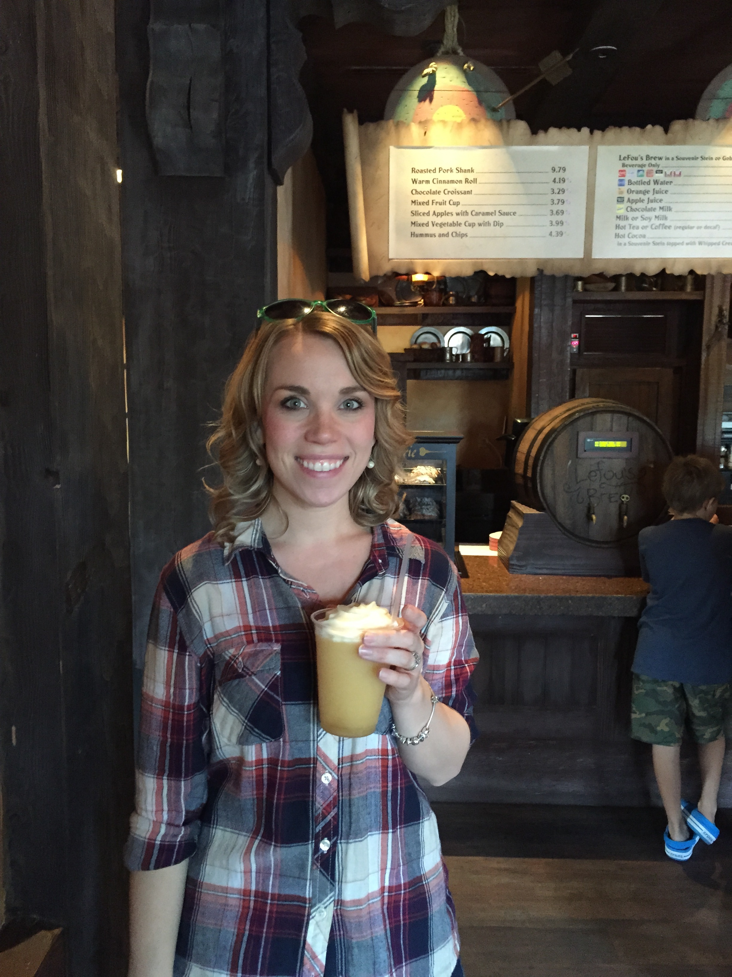 Enjoying LeFou's Brew at Gaston's Tavern! A frozen apple juice with mango cream topping!