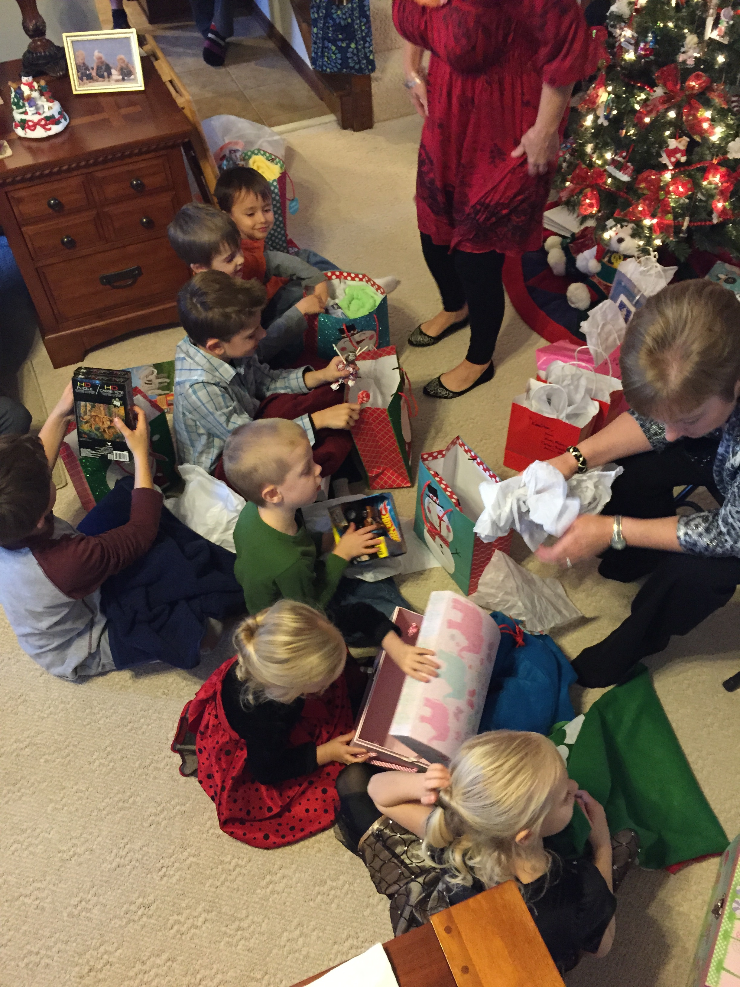 On my mom's side, there are ten of us grandchildren. Some of us are married and some have kids. I loved watching all the babies open their gifts! There's nothing like watching kids tear into presents at Christmastime. It was a flashback to my childhood!