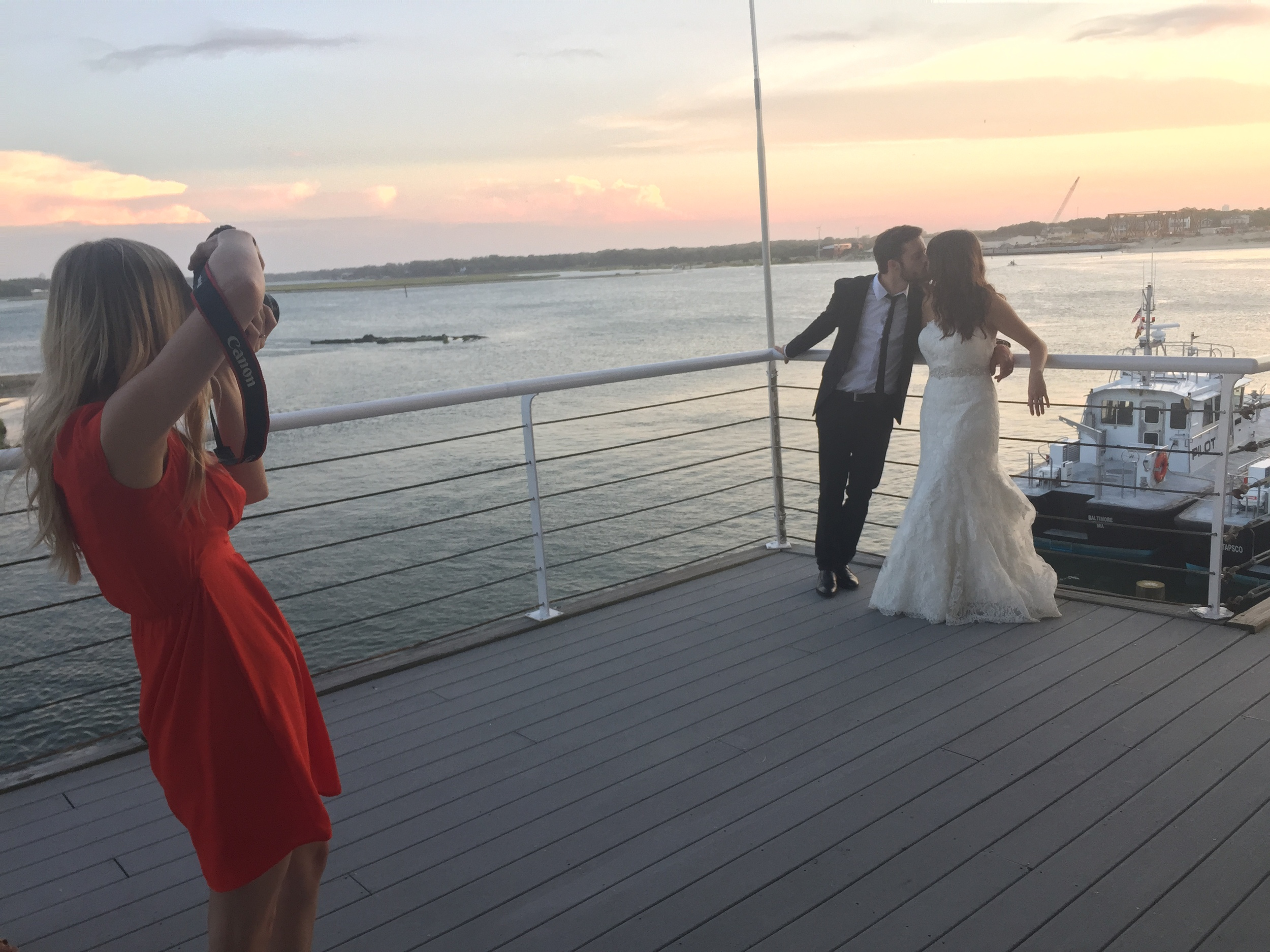 """During dinner, I looked out the window and thought, """"PICTURE!!!"""" The sky was every color imaginable. I grabbed the photographer, Kate, and she took Kyle and Lauren out for a quick minute. Can't wait to see those."""