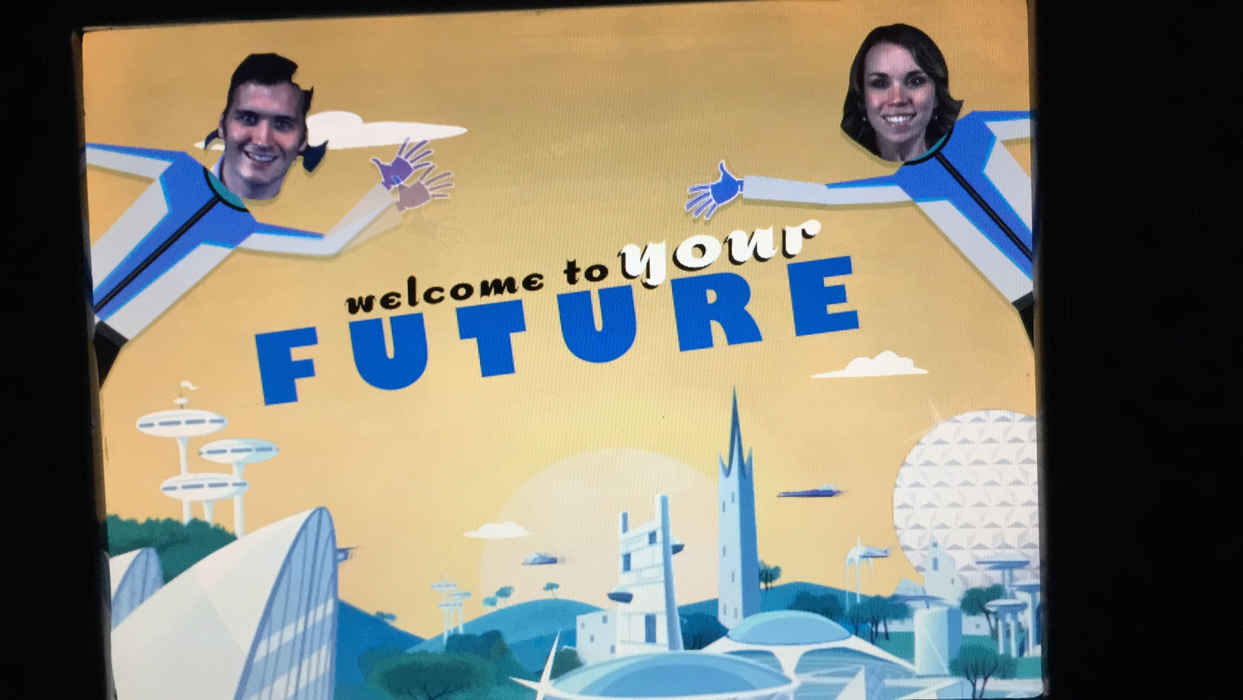 Hahaha!!!! This here is the intro to our Spaceship Earth video from last December. At the beginning of the ride, they take your picture. Before you get off, you watch a little video about how your life will be in the future.