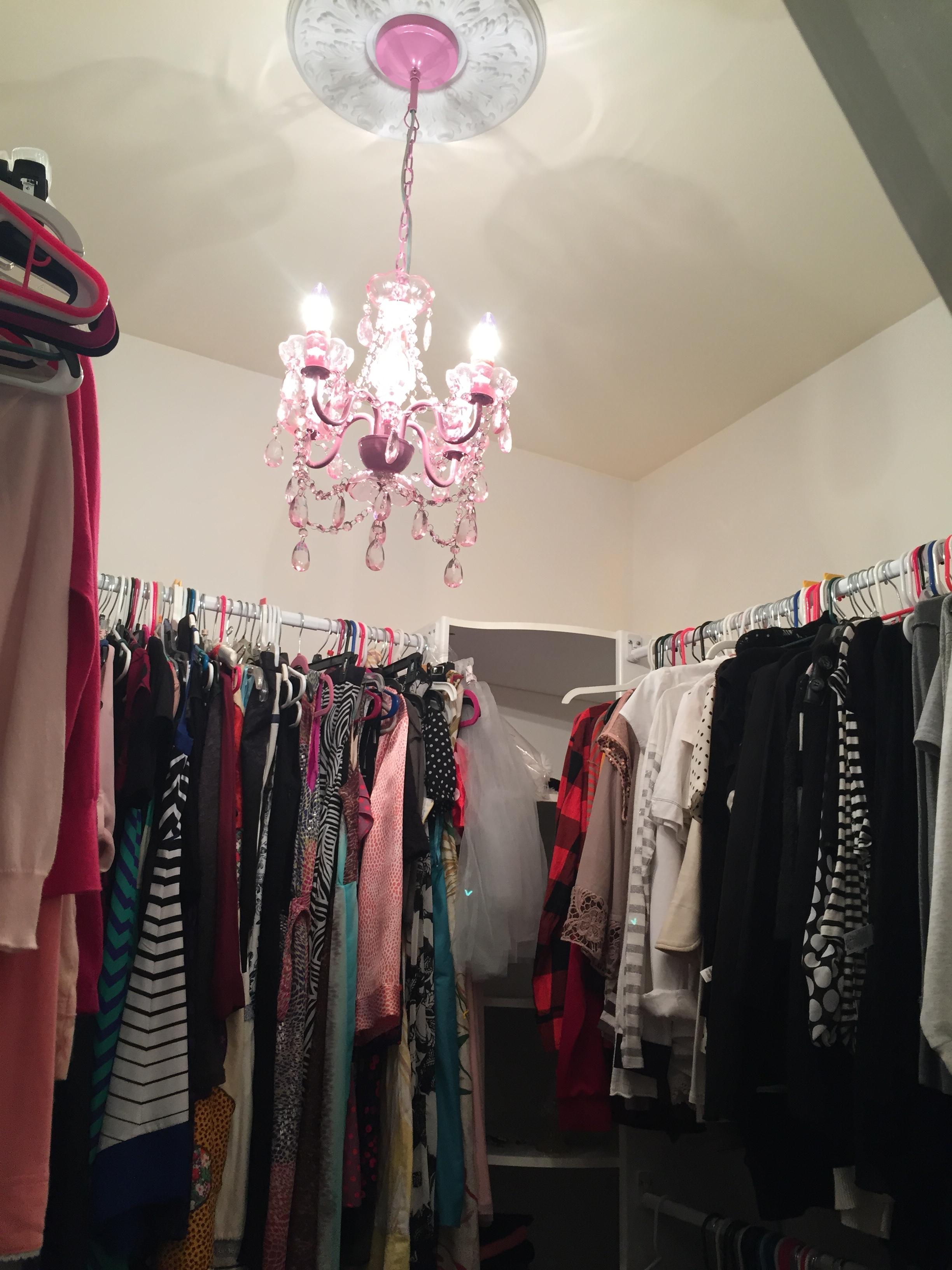 pink chandelier in closet