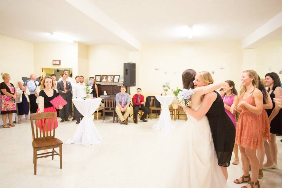 Daytona May Photography  And yes, I'll even set up and clear the chair for your garter toss. ;)
