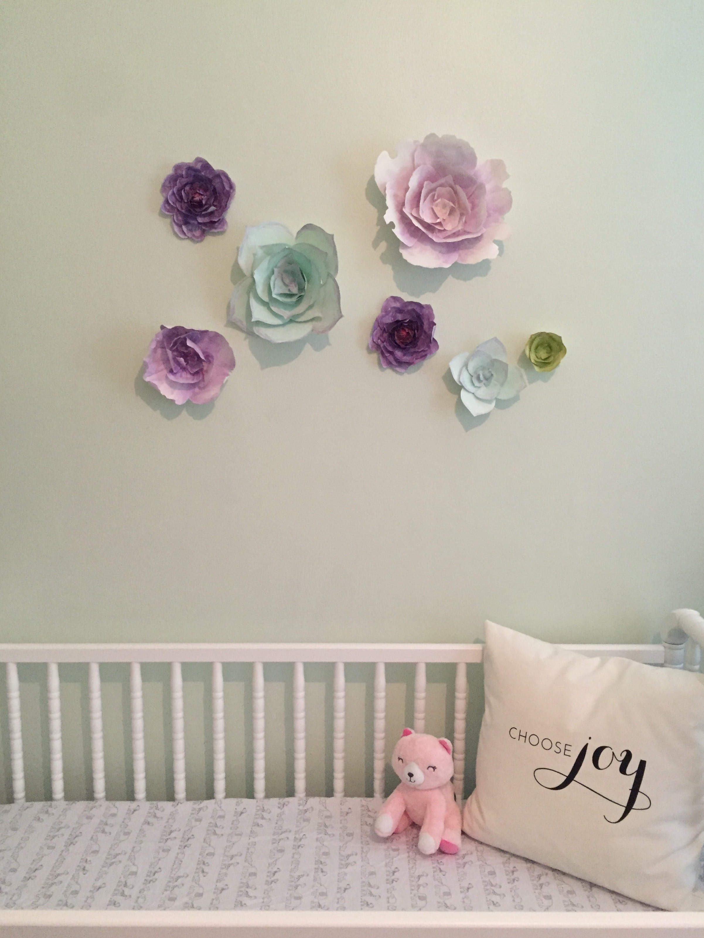 These beautiful paper flowers were made for my branding shoot by my friend Camberly of  Sweet Pear Paper . I didn't want to hang anything heavy over the crib and these are just paper - BINGO! ps- YES, I know you can't keep a pillow in an infant's crib.