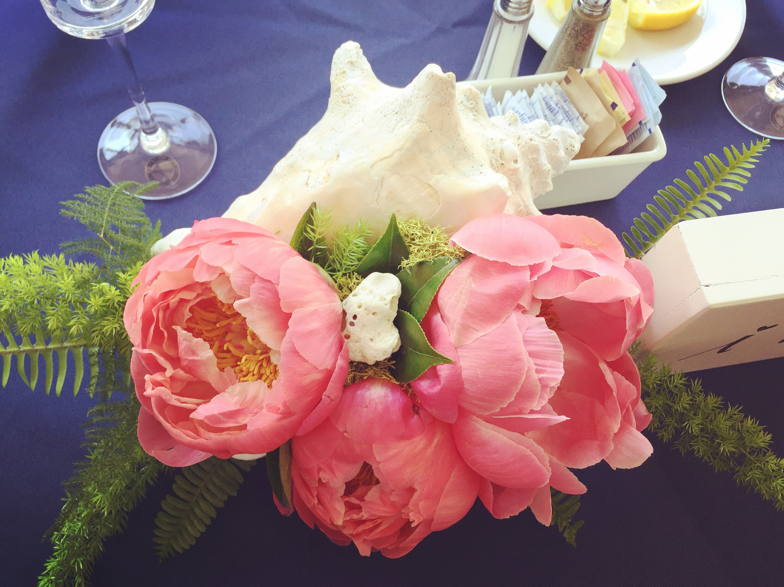 My FAVORITE detail of the day. This conch shell with peonies was made for the sweetheart table. This is something I wish I thought of first, but you can bet I'm going to do my best to make it happen again.