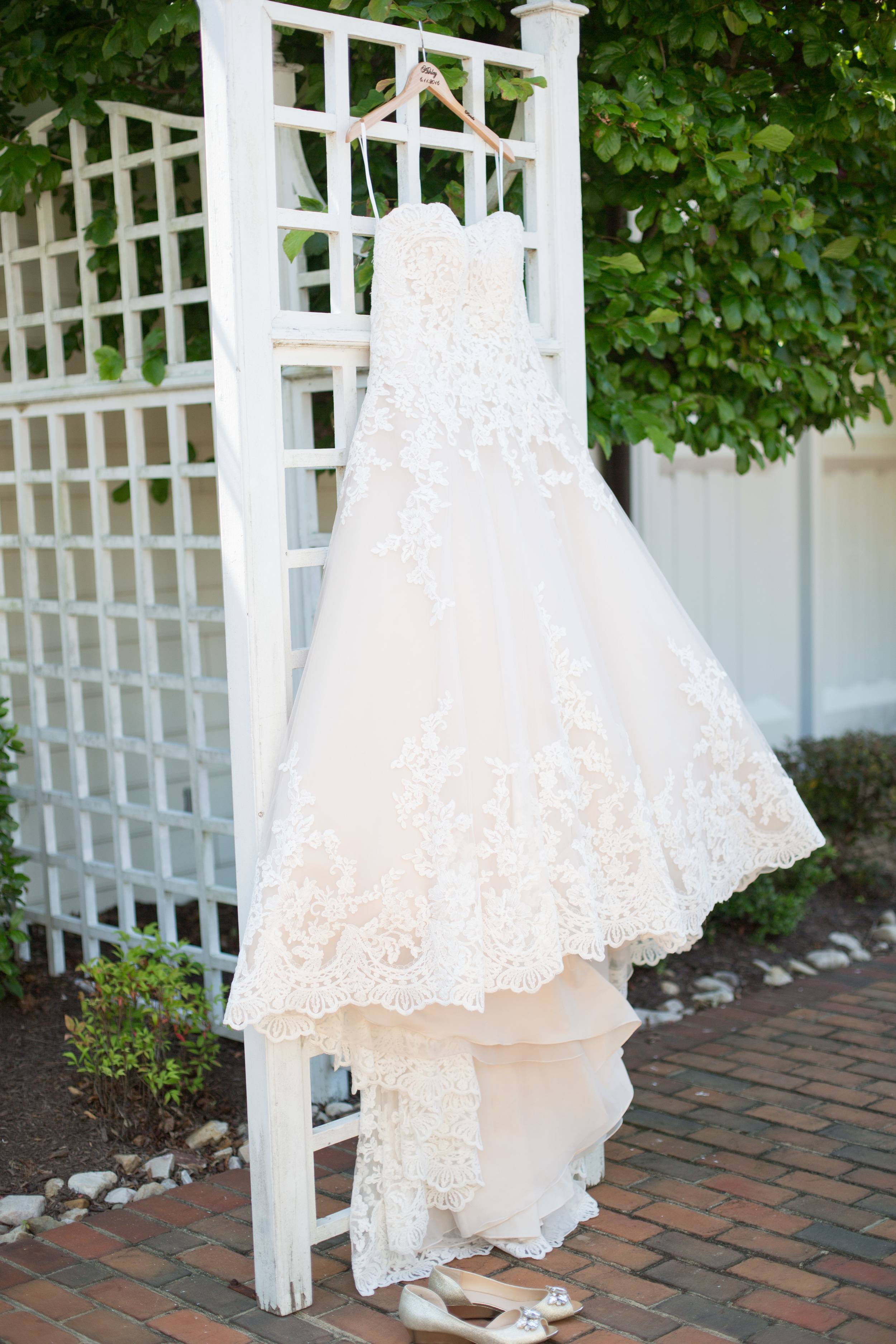 Thankfully, someone put this trellis here knowing a wedding gown would look good hanging from it! ;)