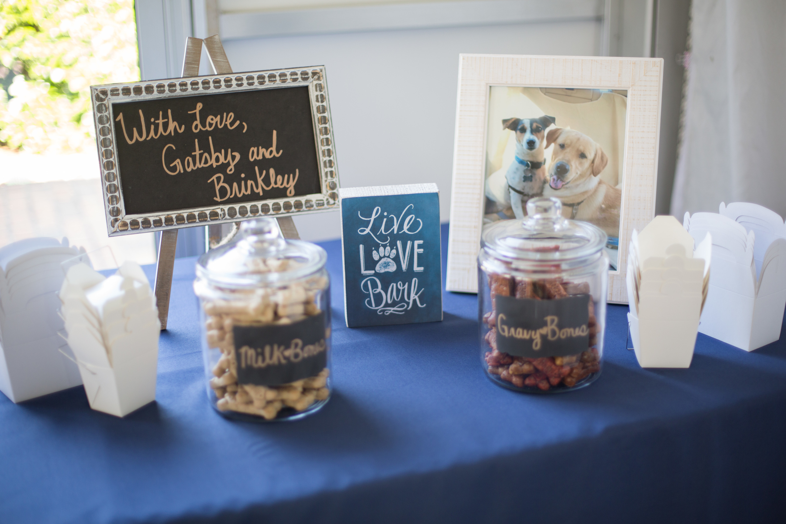 Their pups sent well wishes with a dog treat bar!