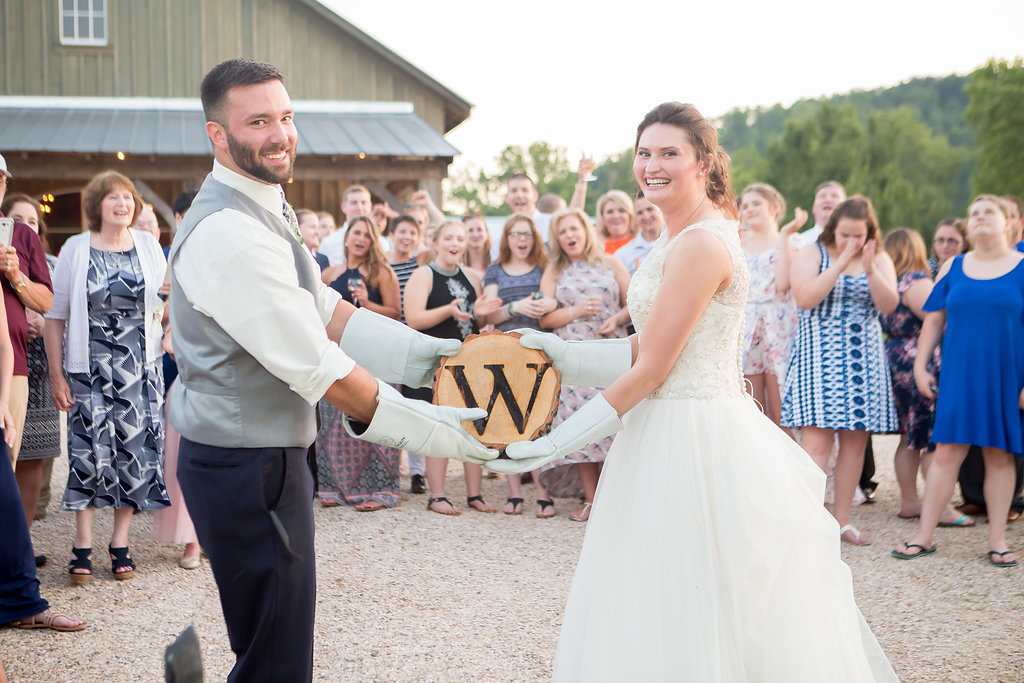 Cassi and Mike decided to incorporate a branding during their wedding reception. Their first act as husband and wife was to permanently mark their last initial into a piece of wood that now belongs in their home. It might go down as the coolest reception moment ever!   Photo: Wild and Wonderful Photography