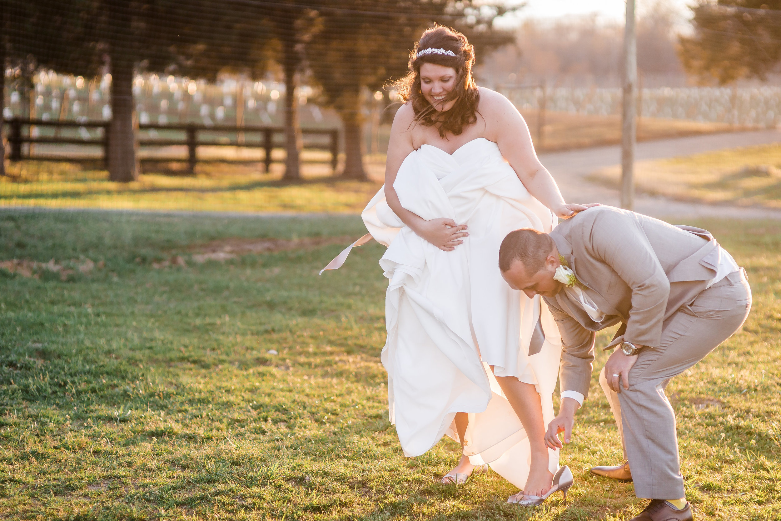 """Casey and Christos, I apologize for not sharing a """"serious"""" picture of the two of you, but this is my favorite! I love how well he took care of her on their wedding day. They are the cutest!  Photo: Associate Ashley, Sharon Elizabeth Photography"""