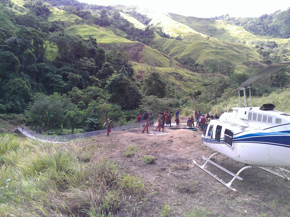 Helicopter at community development charter for footbridge construction, Papua New Guinea (PNG)