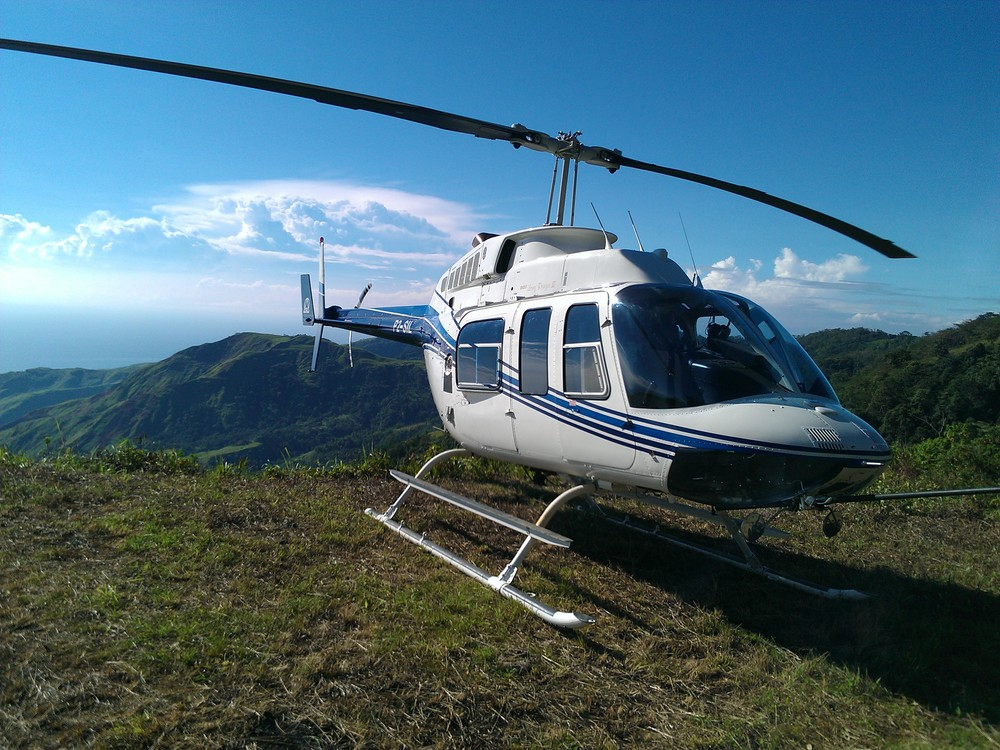 Helicopter on survey charter, Huon Peninsula, Papua New Guinea (PNG)