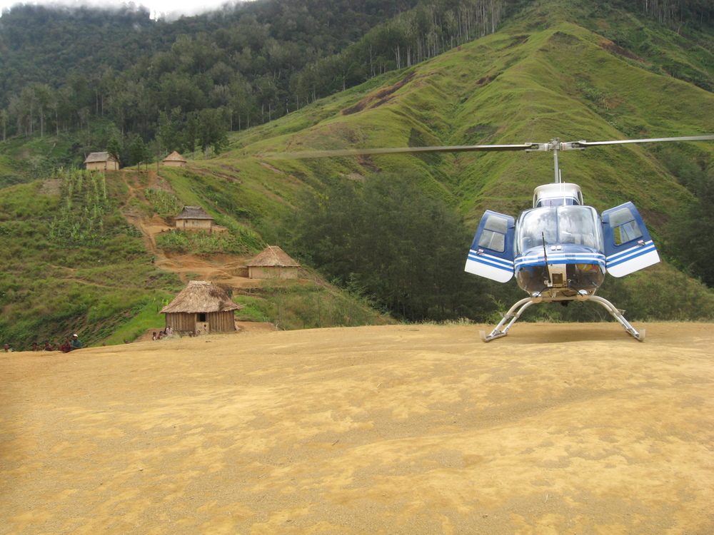 Helicopter in village, Papua New Guinea (PNG)