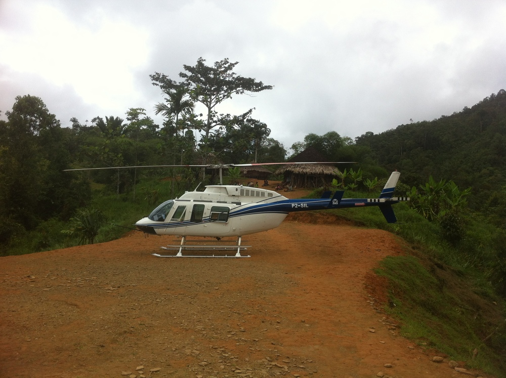 Helicopter on ridge for community development charter, Papua New Guinea (PNG)