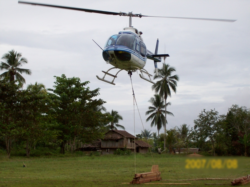 Helicopter lifting timber sling load