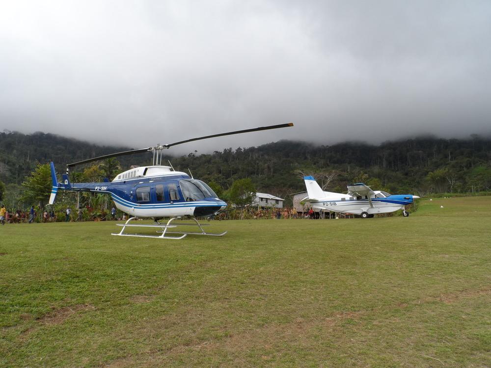 Bell Long Ranger helicopter and Kodiak on community development hire