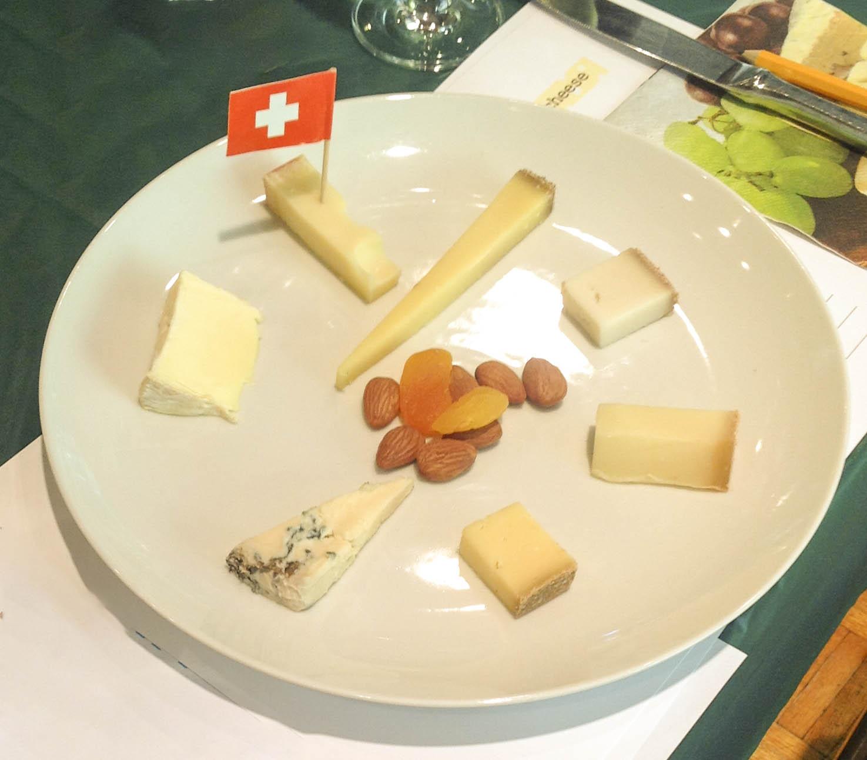 Clockwise from flagged cheese:  18-month Emmentaler; Heublumen; Zeigenkonig; Appenzeller Extra; Berggenuss; Jersey Blue; Moser Screamer