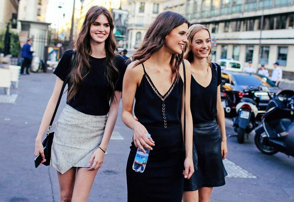 Three models off-duty during Paris Fashion Week.