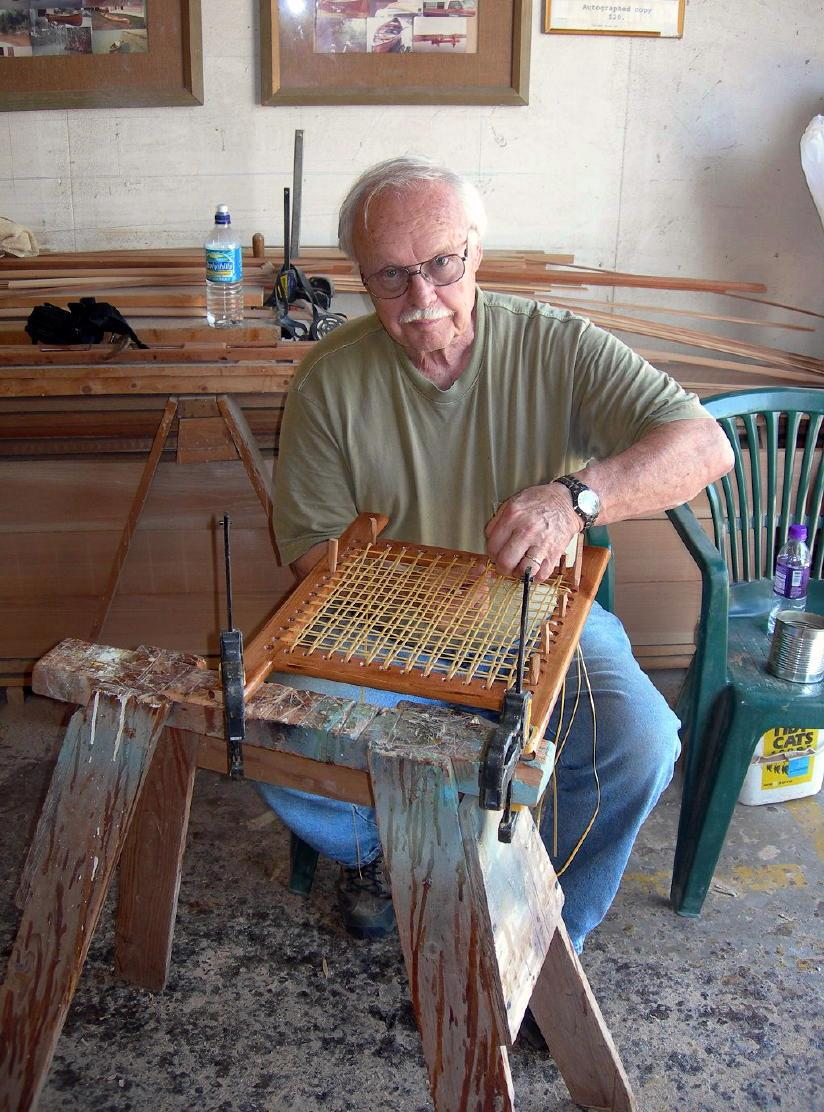 Dad is hand caning the seat for Steven's Wee Lassie Canoe, 2006.