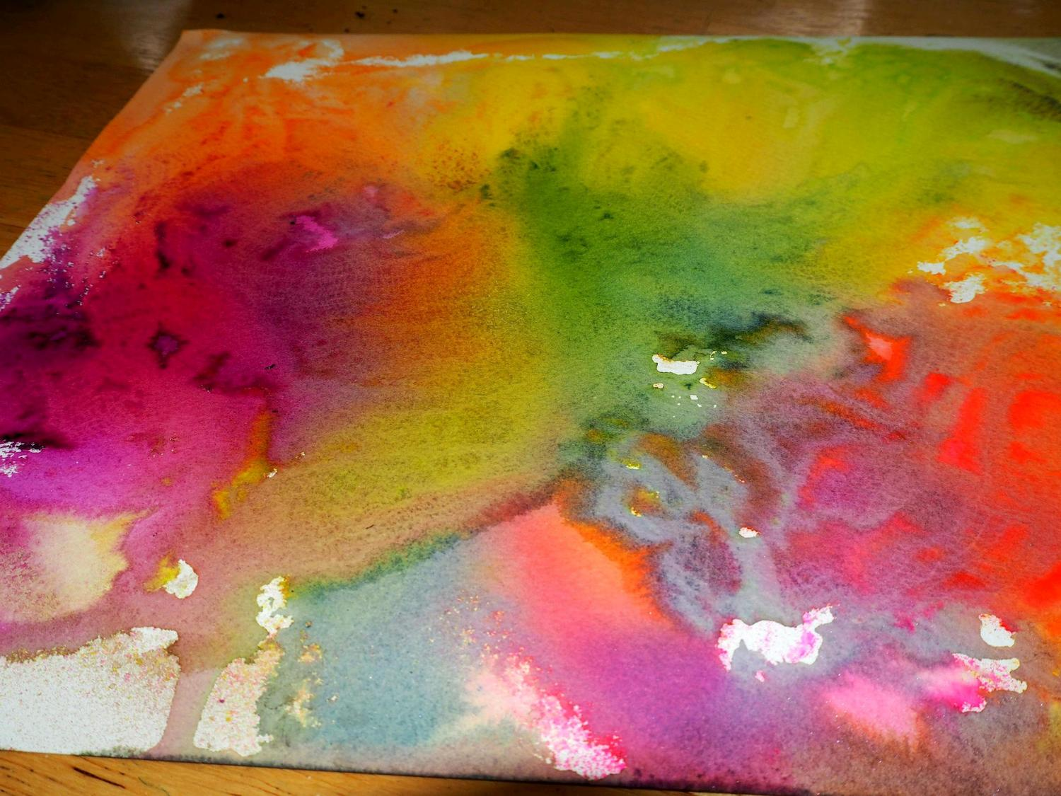 The leftover dyes on the watercolor paper I sprayed on top of.