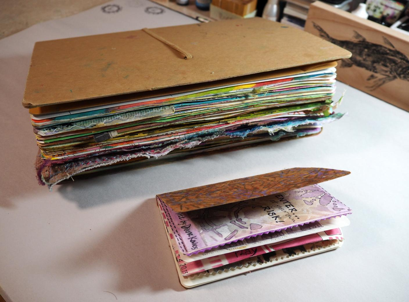 """The difference in size between my larger 9"""" x 12"""" Dylusions art journal and my 3-1/2"""" x 5"""" moleskine journal . . ."""