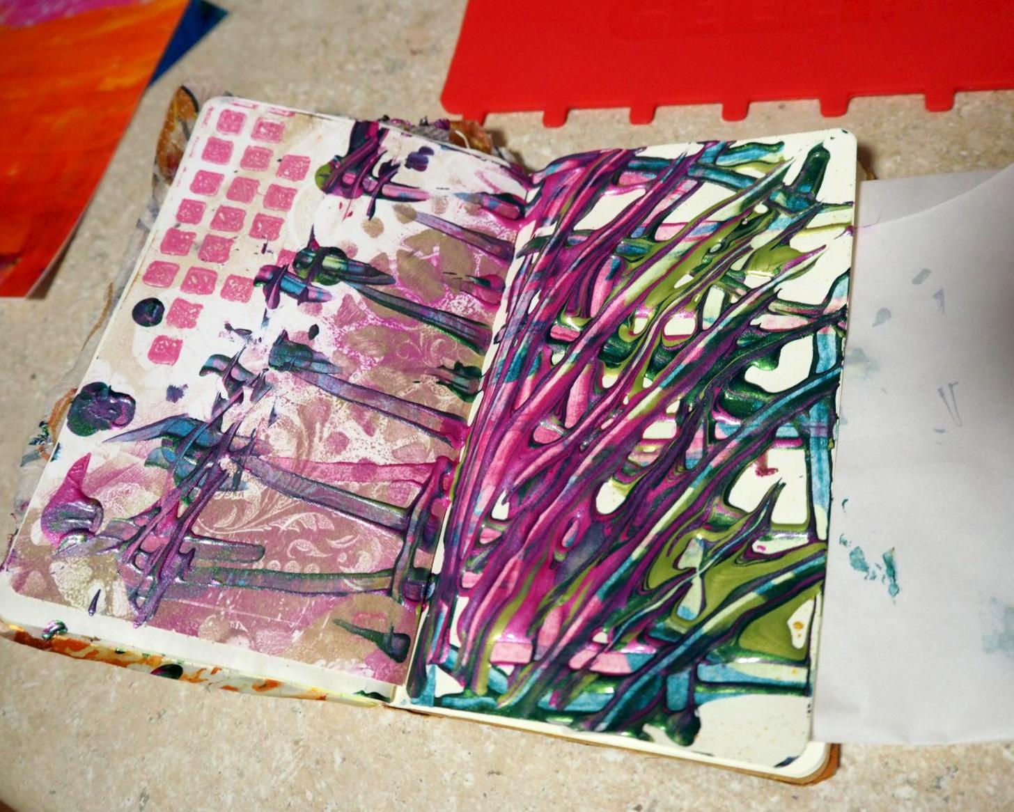 I used a new tool from Gelli Arts to spread the paint out. (see top of photo)  * It was a huge tool for such a little book!