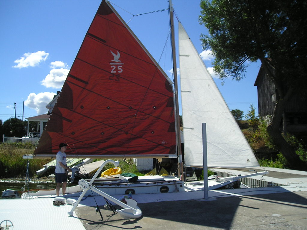 At the dock, testing sails, rigging