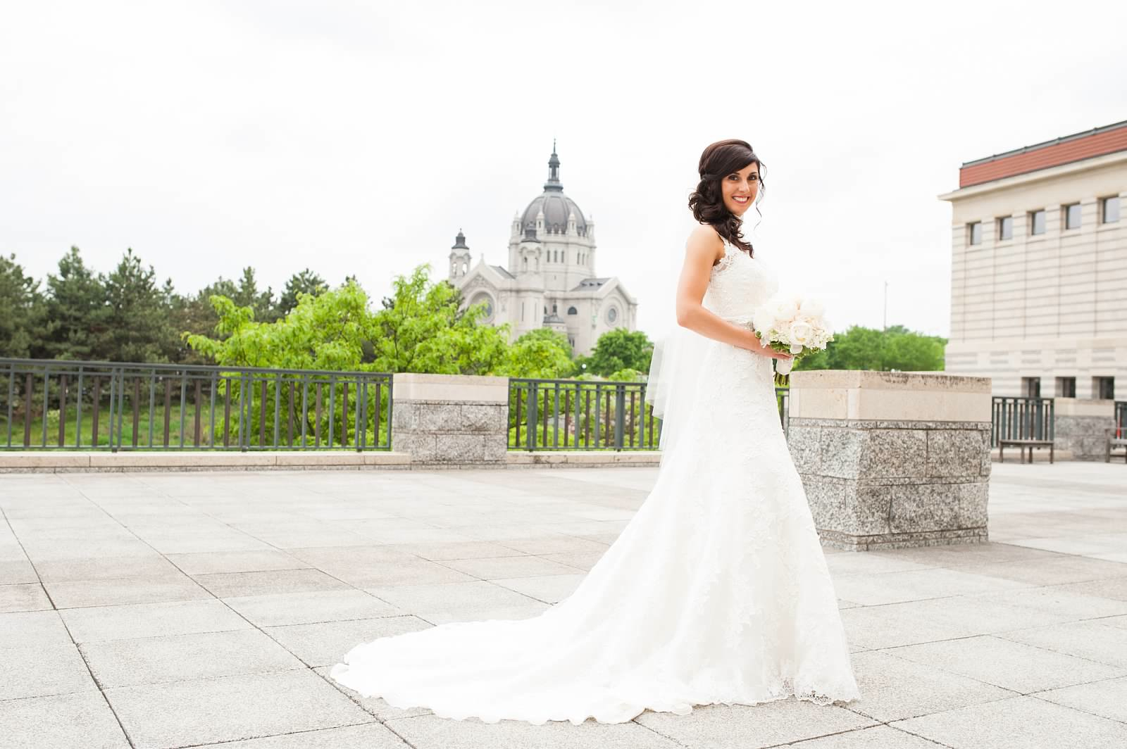 Bride with white peony bouquet at the Minnesota History Center with the St.jpg