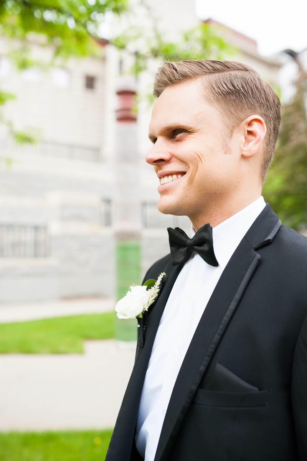 Groom with white boutonniere 3.jpg