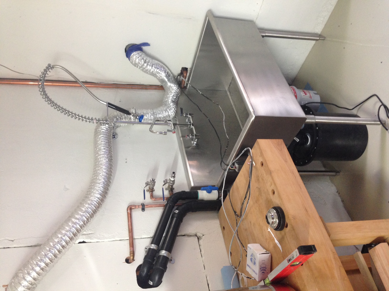 Sewage Ejection pump, drains, vent, water supply lines, garbage disposal and faucet install.