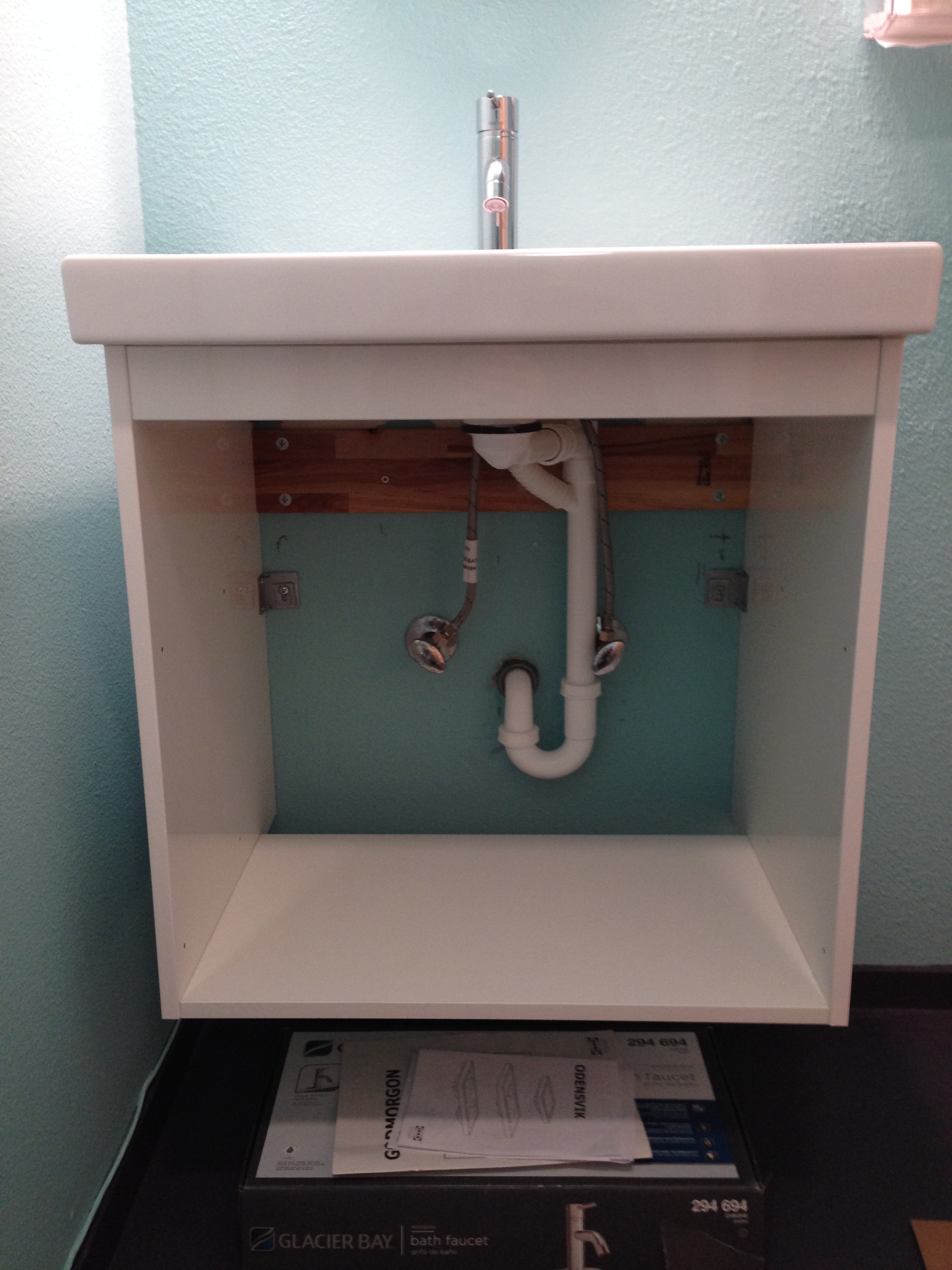 Floating Cabinet with new Drains and Faucet