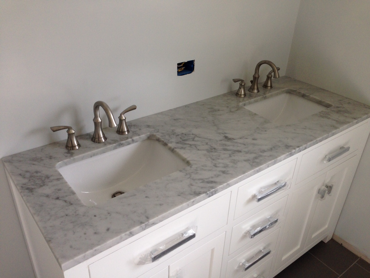 Finished bathroom dual vanity/lav with all new drains, vents supply lines and faucets.