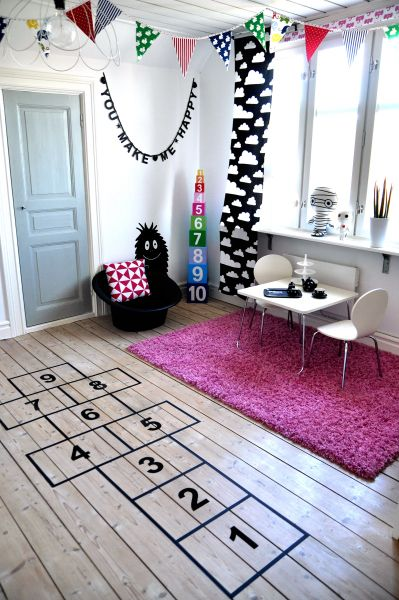 If hopscotch is the thing which is a favourite game, then use black tape to design on the floor, when it´s no fun anymore, you just remove the tape and no harm is done.