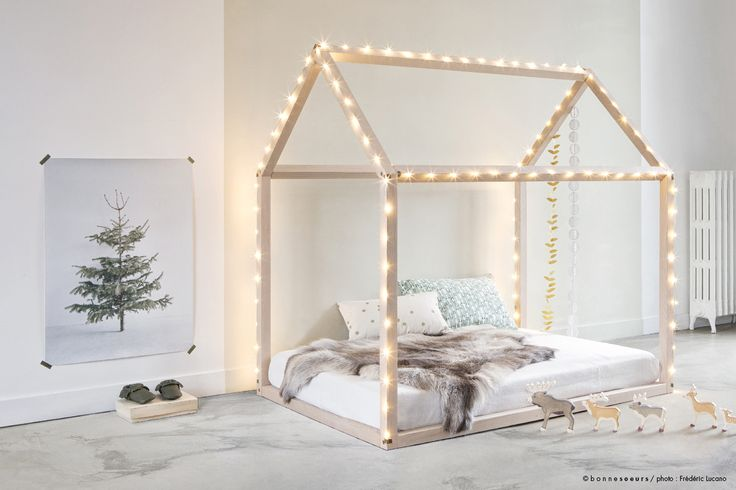 Create this wooden frame as a house for your kid. They will love it and it looks fantastic. Decorate with christmas lights. Most fathers can put together 15 lengths of wood.                                   Enjoy, Christina