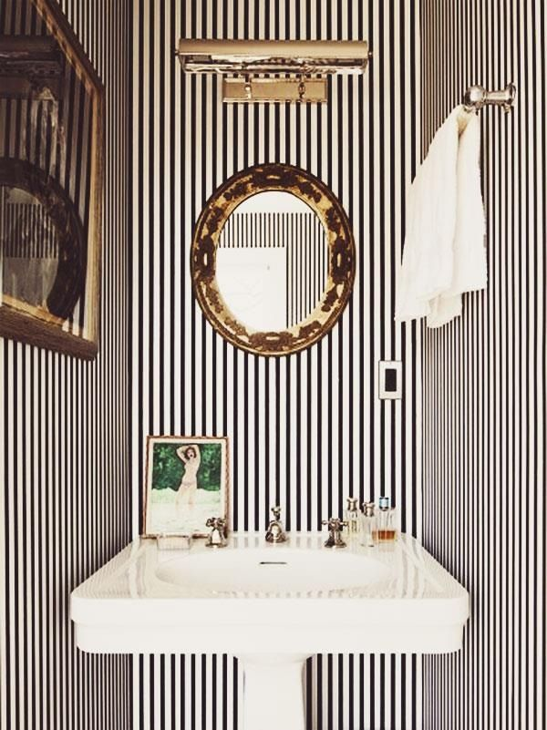 Do it ALL wall-paper, gold, chandelier, stripes, paintings, lights .....go crazy.