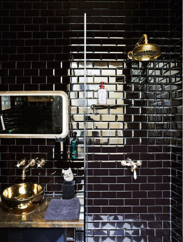 Black tiles and brass in bathroom. Uber cool !