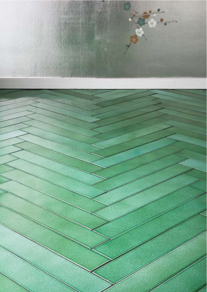 Made a mano´s amazing light green floor tiles put in a herringbone effect is a new and beautiful way of using ceramic tiles.