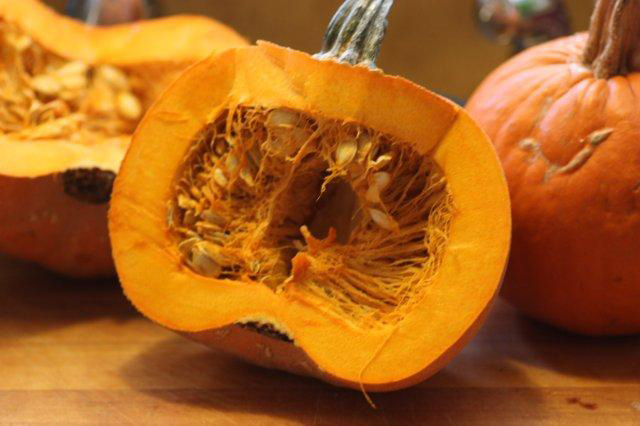 This 'Winter Luxury' pumpkin half needs to be cleaned and the seeds saved for roasting.