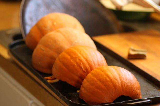 These inverted pumpkin halves are ready to roast or steam.
