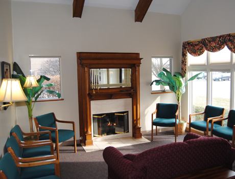 Comfortable reception area with a fireplace and beverage service