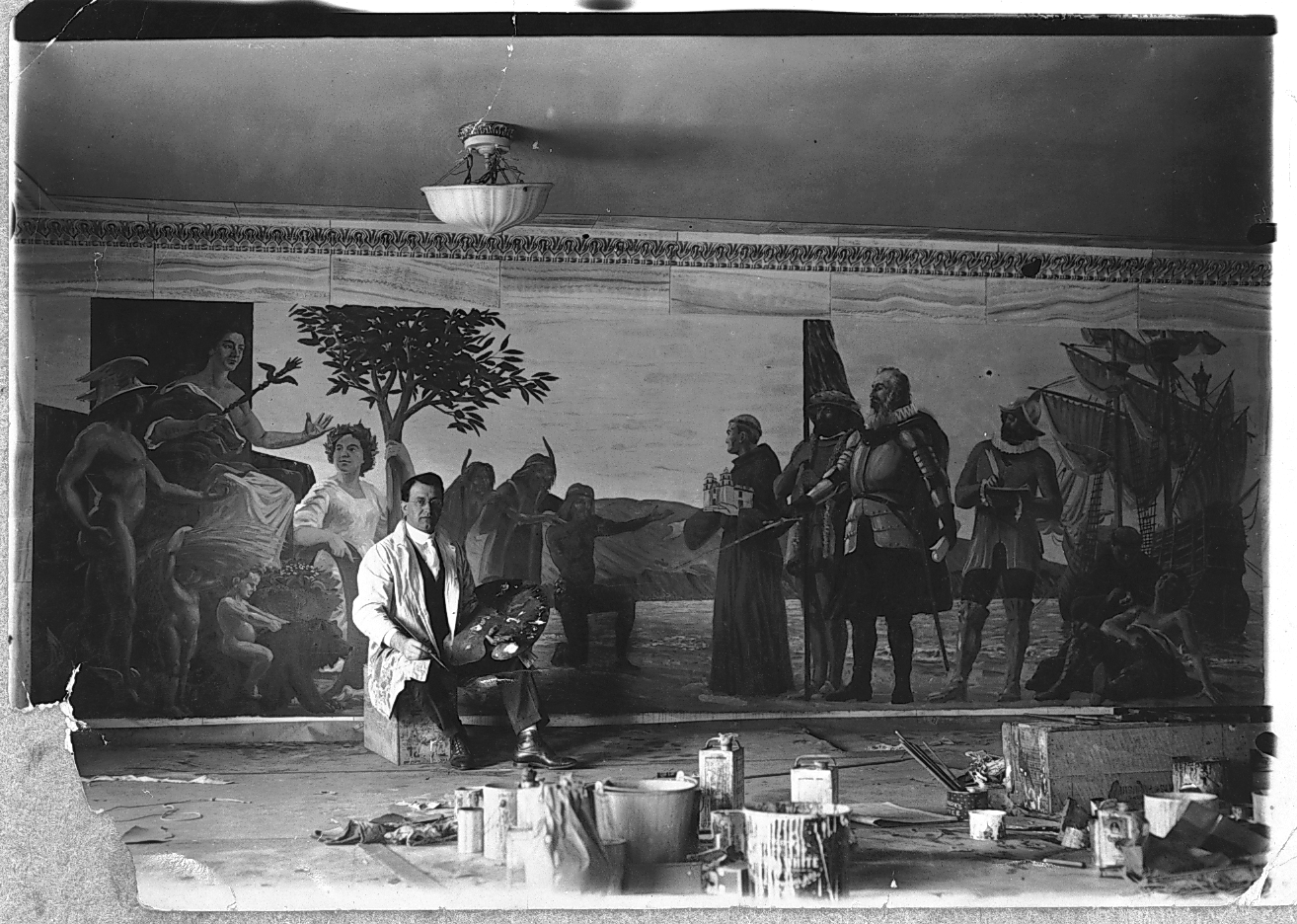 This publicity photograph shows Fausto Tasca completing work on a mural for the Farmers' and Merchants' Bank. The bank was located in Long Beach, California.