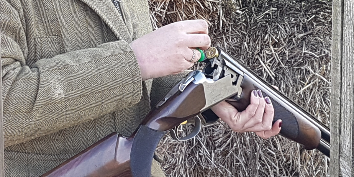 Loading a gun at a clay shoot - photo by Stella Gooch