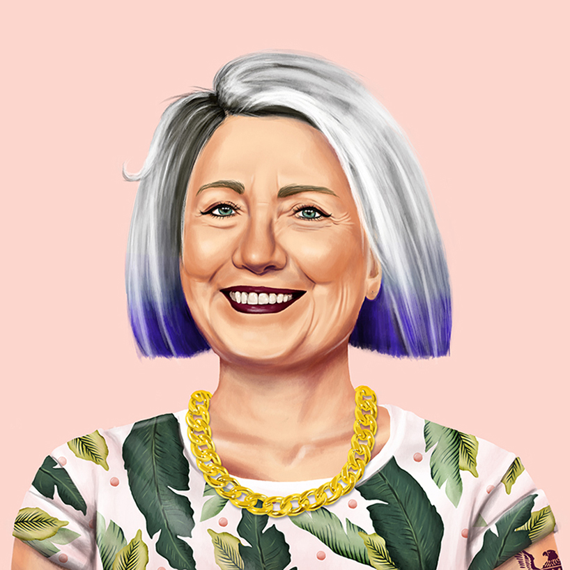 Hillary Clinton, is a half-purple haired lady in a leafy tee together with a chunky gold necklace.