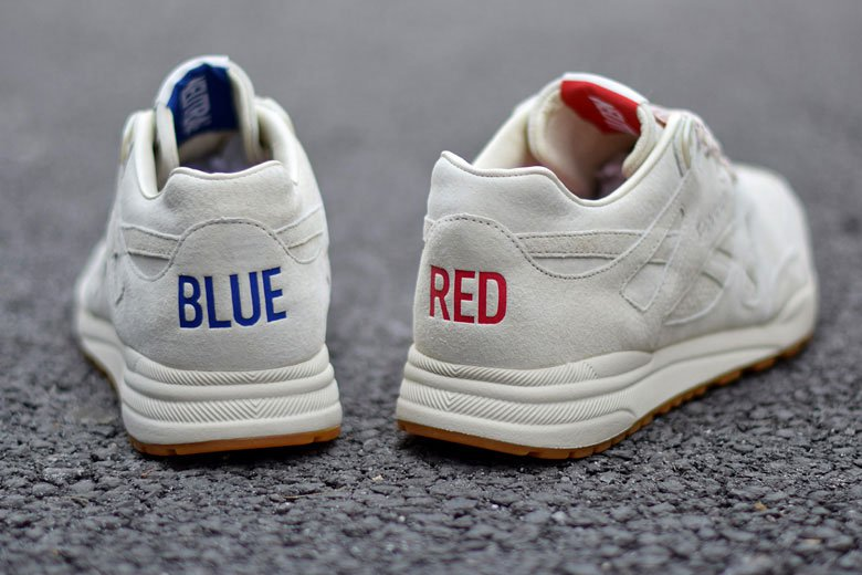"""The one shoe is themed blue, the other blue, but the tongue of each reads """"NEUTRAL"""""""