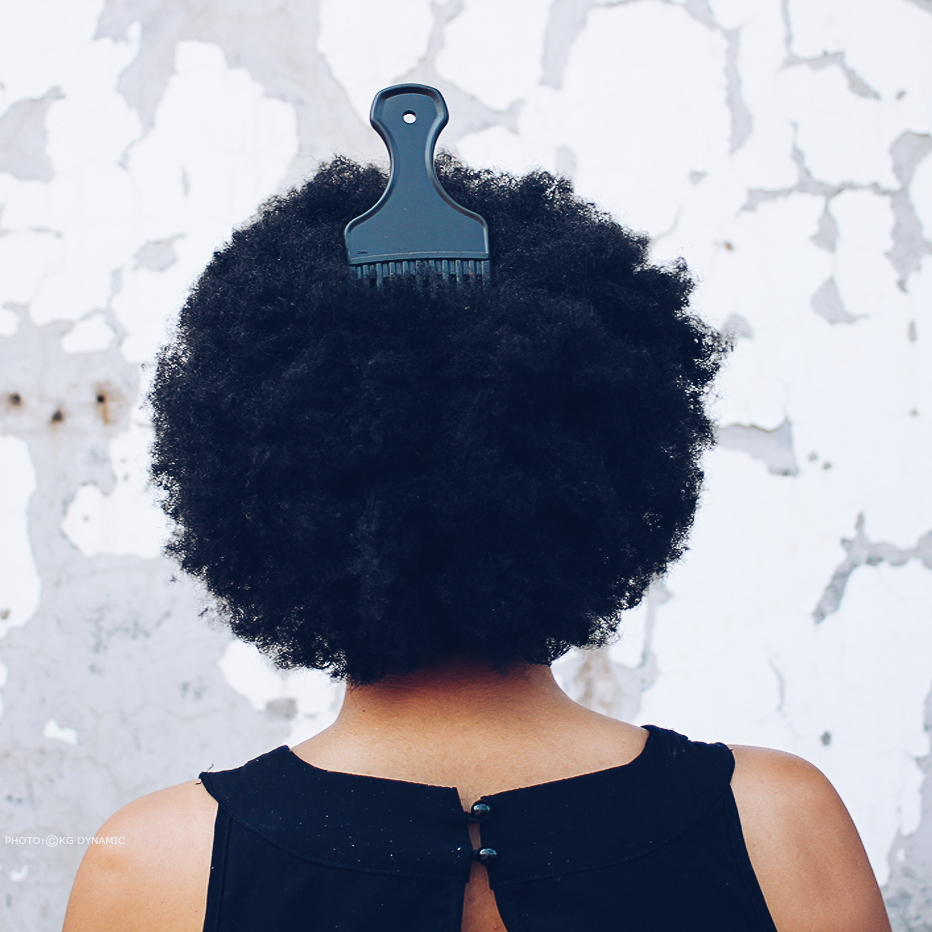 The hair of a woman is said to be her crown and she wears her natural fro with pride