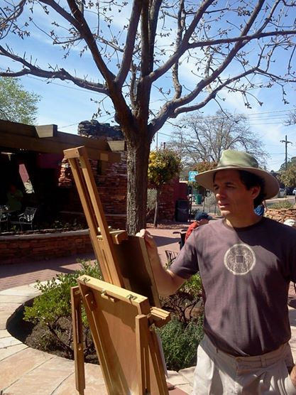 Sedona artist, Steve Simon, painting a landscape outside Sedona Green Gallery & Gifts. Steve's work is available at Sedona Green.