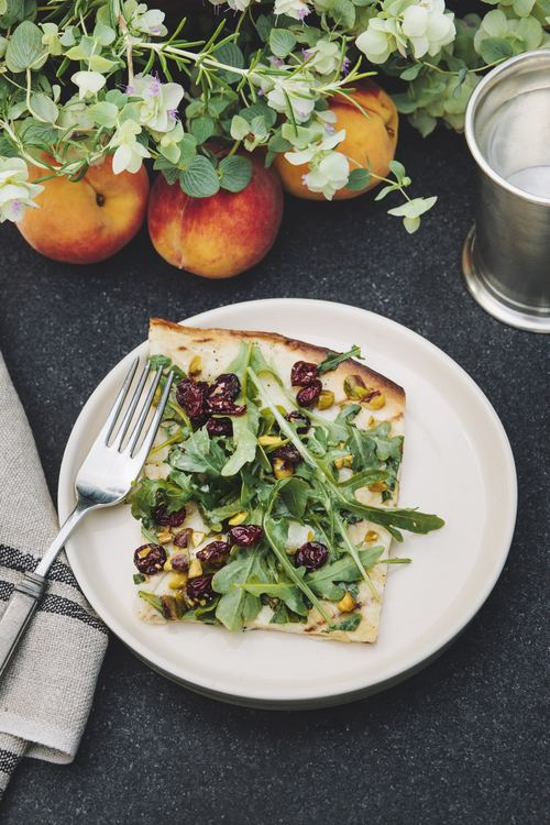 - Any creative way to disguise salad as pizza deserves applause. Pizzas are a great way to use up bits of this and that in the refrigerator. Arugula is a tough sell at many family tables--that is until it becomes pizza. Dubbed