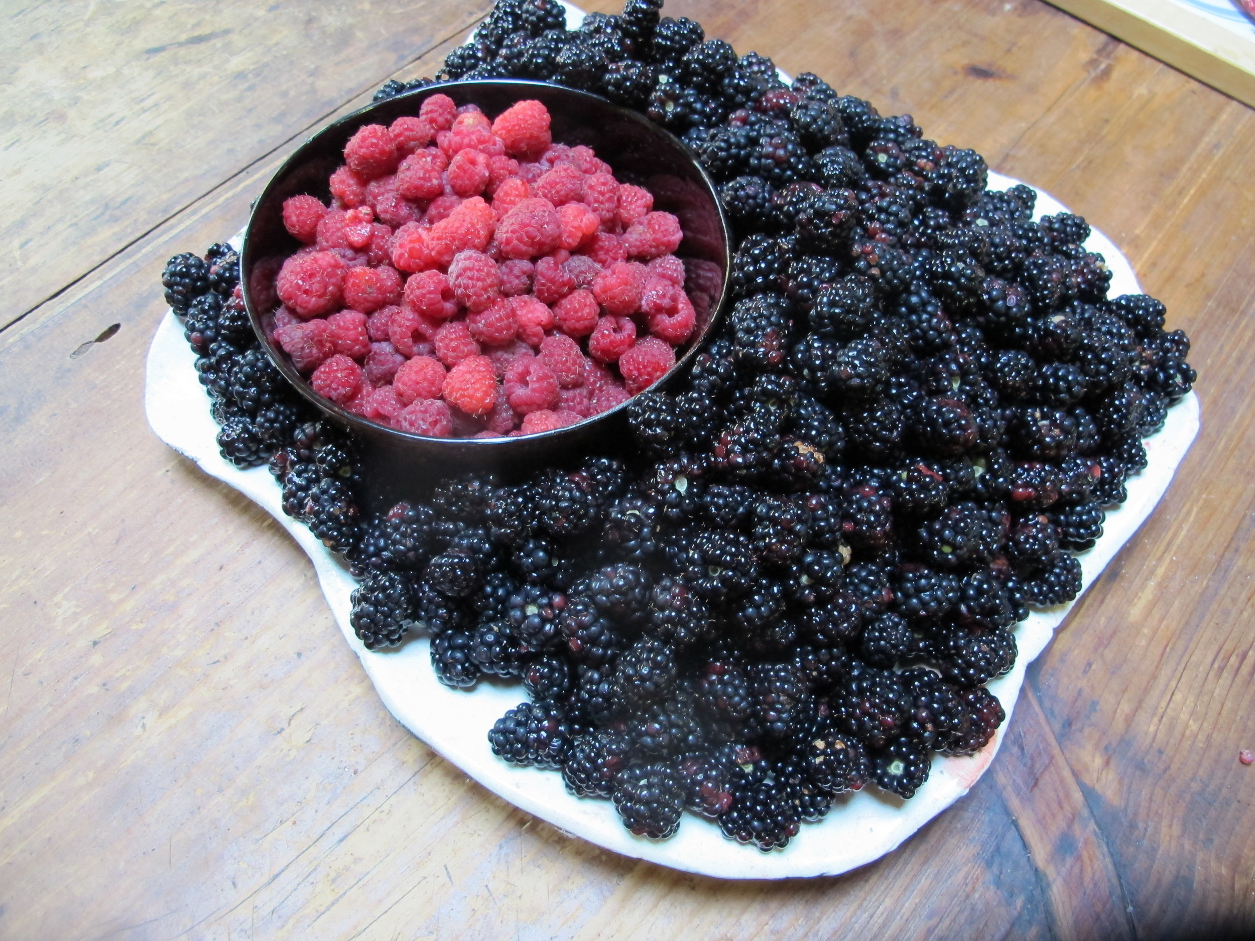 Blackberries and red raspberries, the summer jewels that sit in the freezer will become part of our wild berry relish.