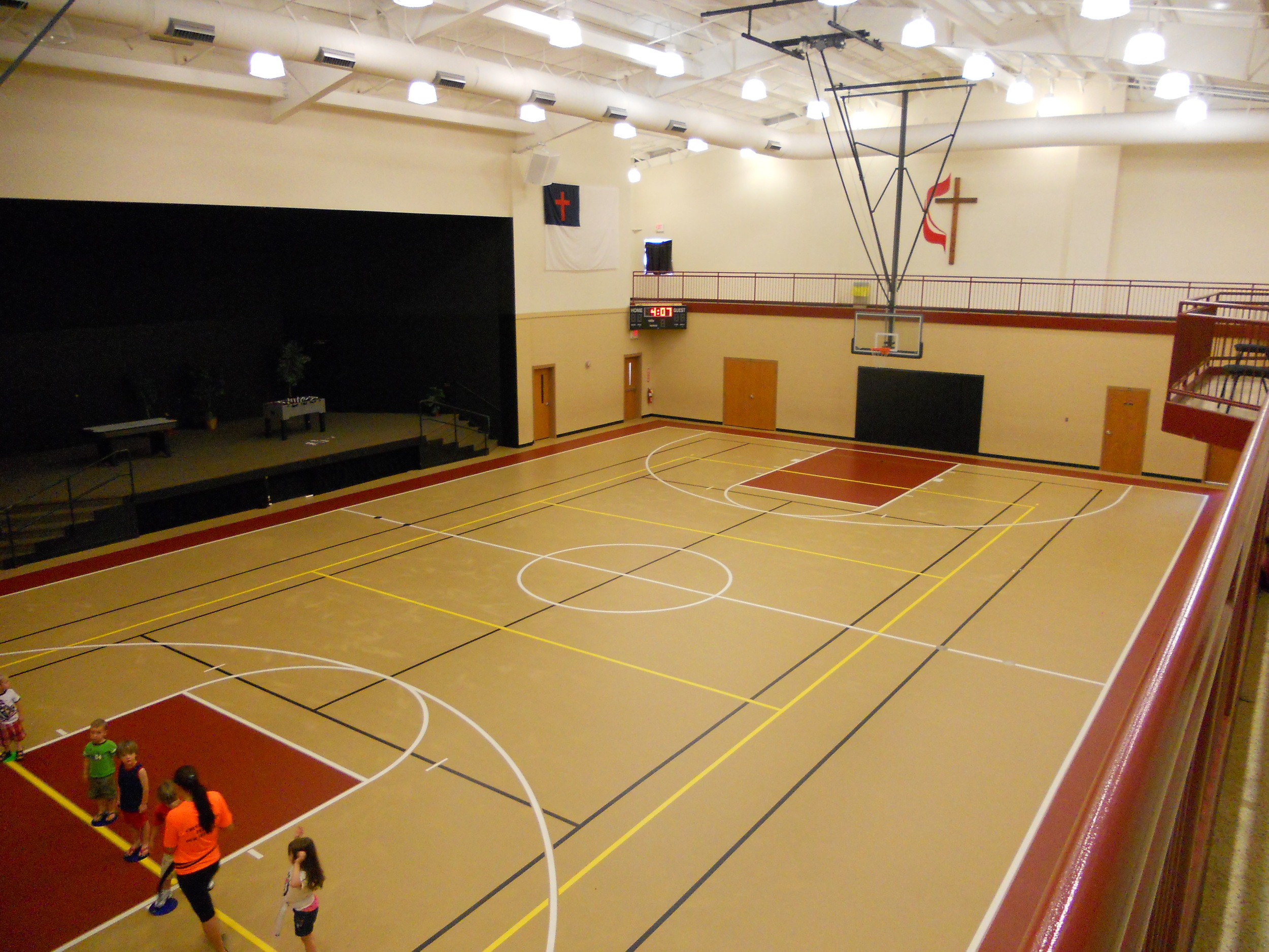 Gym with stage area on the left; walking track on upper level